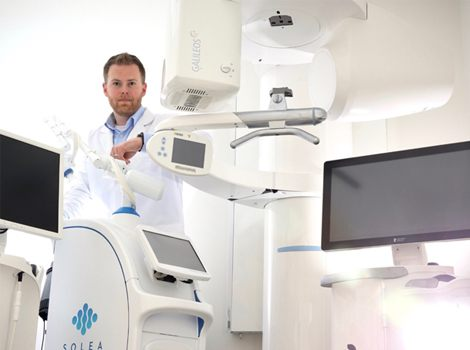 Dr. Tubo with advanced technology, including CBCT and dental laser