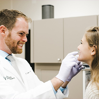 Dentist performing a dental exam
