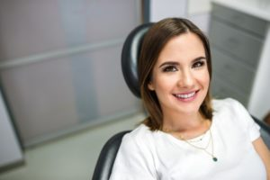 Woman smiling in dental chair with healthy teeth